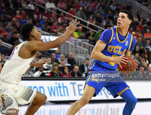 Allonzo Trier of the Arizona Wildcats guards Lonzo Ball of the UCLA Bruins during a semifinal game of the Pac12 Basketball Tournament at TMobile...
