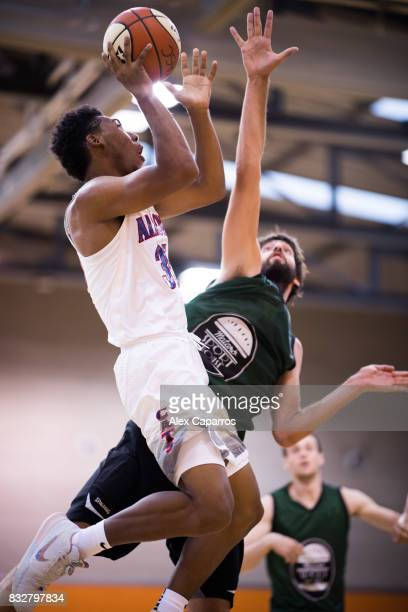 Allonzo Trier of the Arizona Wildcats shoots over Gerbert of the Mataro AllStars during the Arizona In Espana Foreign Tour game between Mataro...
