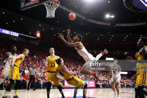 Allonzo Trier of the Arizona Wildcats shoots over Max Portmann of the UMBC Retrievers during the second half of the college basketball game at McKale...