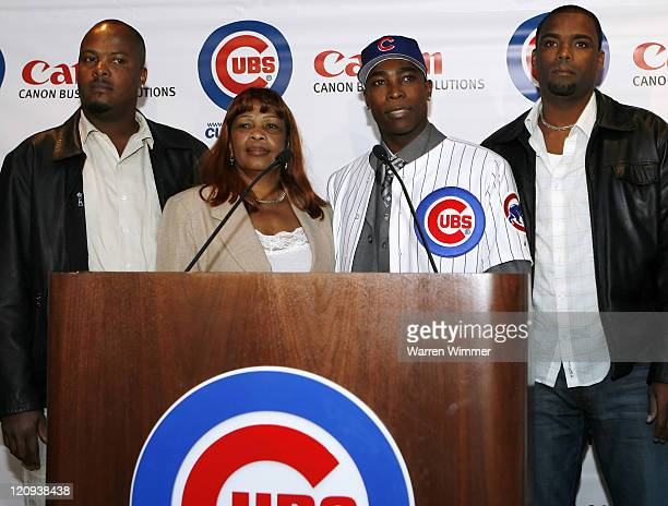 AllStar Alfonso Soriano of the Chicago Cubs flanked by his two brothers and mother meets the Chicago media at the Stadium Club at Wrigley Field...