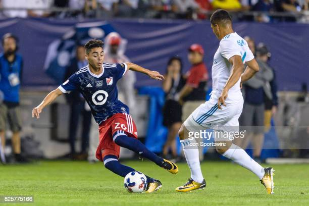 AllStar and Atlanta United FC midfielder Miguel Almiron plays the ball as Real Madrid midfielder Casemiro defends in the second half during a soccer...