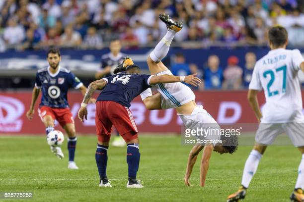 AllStar and Orlando City FC Forward Dom Dwyer and Real Madrid defender Jesus Vallejo get tangled up in the second half during a soccer match between...