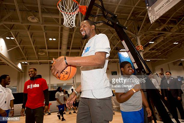 NBA allstar Kevin Durant of the Oklahoma City Thunder smiled after 14yearold Shevon Campbell from St John Fisher School in Brampton hit a shot at the...