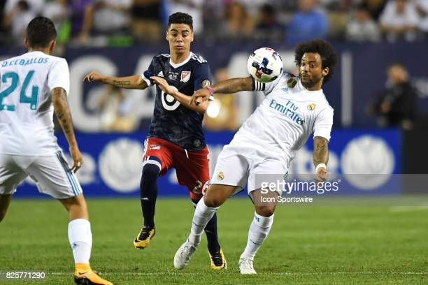 AllStar Miguel Almiron and Real Madrid defender Marcelo battle for the ball in the second half during a soccer match between the MLS AllStars and...