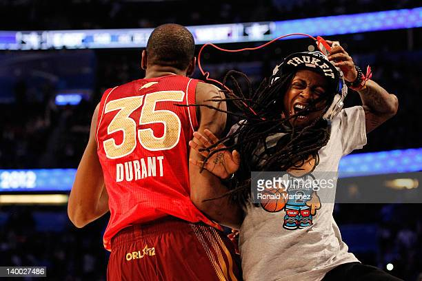 AllStar MVP Kevin Durant of the Oklahoma City Thunder and the Western Conference celebrates with hiphop artist Lil' Wayne during the 2012 NBA AllStar...