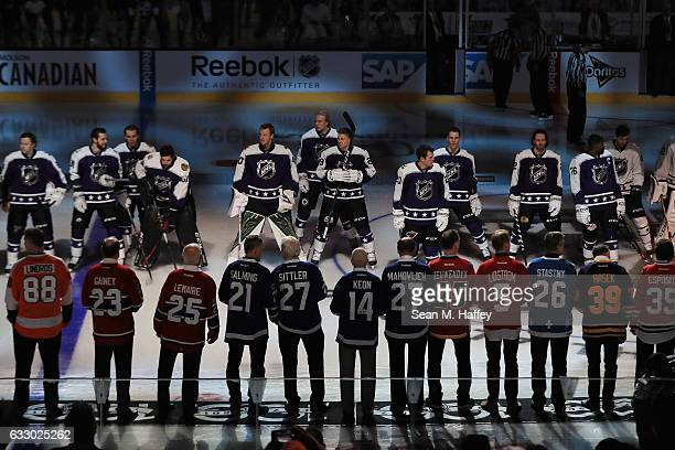 AllStar players stand on the ice with members of the NHL 100 prior to the 2017 Honda NHL AllStar Game at Staples Center on January 29 2017 in Los...
