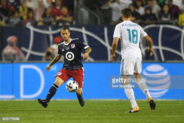 AllStar Sebastian Giovinco controls the ball next to Real Madrid midfielder Marcos Llorente  in the first half during a soccer match between the MLS...