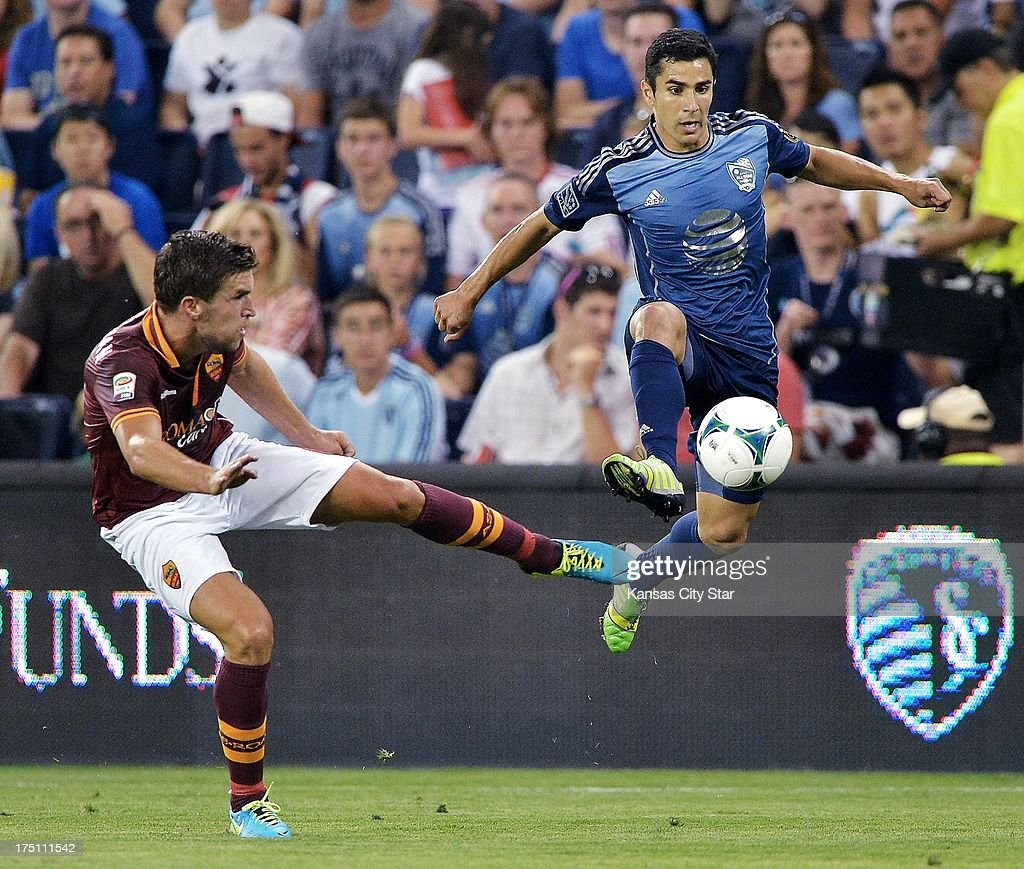 MLS All-Stars forward Camilo Sanvezzo and AS Roma midfielder Kevin Strootman, left, reach for a pass in the second half of the MLS All-Star Game on Wednesday, July 31, 2013, at Sporting Park in Kansas City, Kansas. Roma defeated the MLS squad, 3-1.
