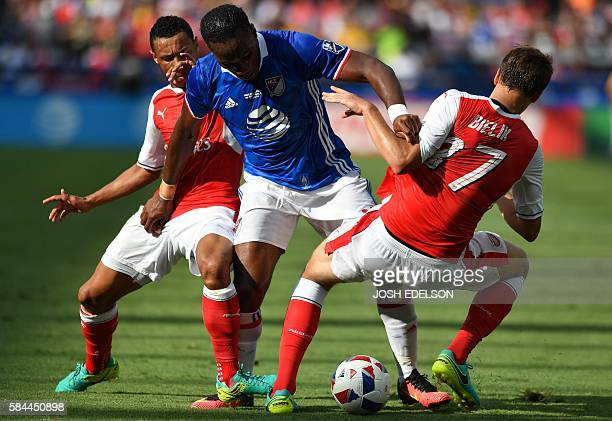 MLS AllStars forward Didier Drogba struggles to control the ball while holding onto Arsenal defender Krystian Bielik during an MLS AllStar match at...
