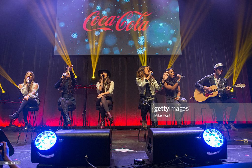 Ally Brooke, Camila Cabello, Lauren Jauregui, Dinah Jane Hansen, and Normani Hamilton of Fifth Harmony perform at the Z100 & Coca-Cola All Access Lounge at Hammerstein Ballroom on December 13, 2013 in New York City.