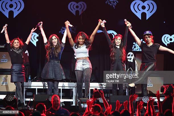 Ally Brooke Lauren Jauregui Normani Kordei Camila Cabello Dinah Jane Hansen of Fifth Harmony poses backstage at KISS 108's Jingle Ball 2013 at TD...