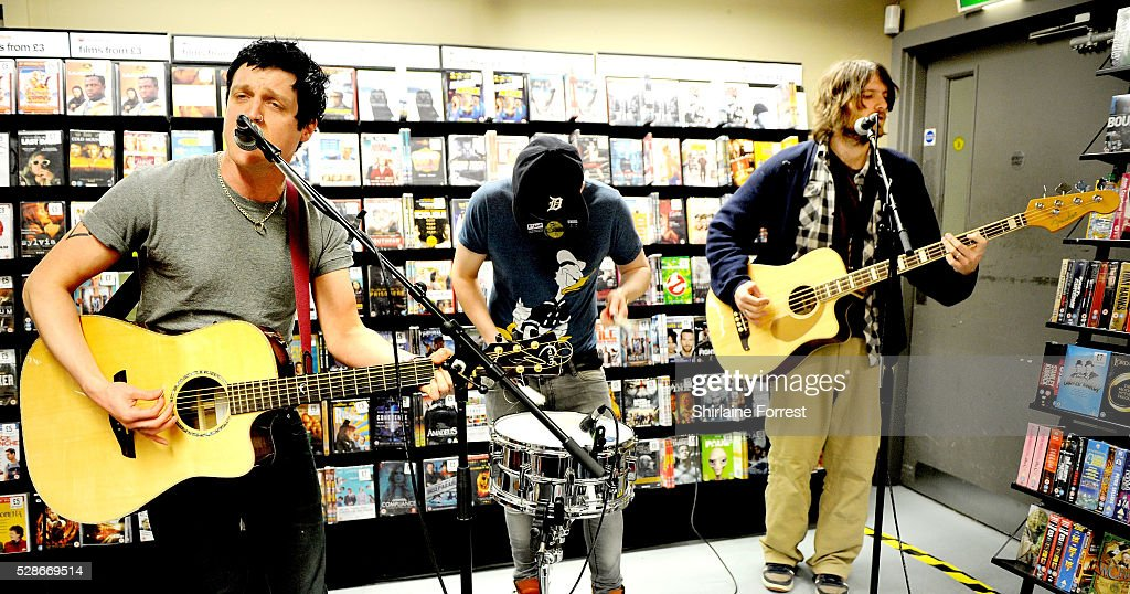 Ally Dickaty, Danny Dolan and Matt Rose of The Virginmarys perform live and sign copies of their new album 'Divides' at Fopp on May 6, 2016 in Manchester, England.