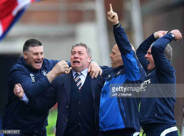 Ally McCoist coach of Rangers celebrates a goal during the Scottish Clydesdale Bank Scottish Premier League match between Rangers and Celtic at Ibrox...