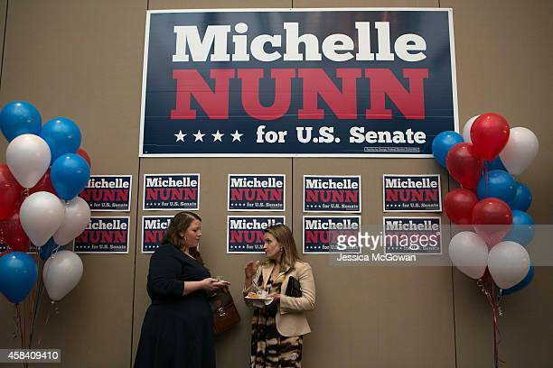 Ally O'Callaghan and Catherine Fitch socialize and await results at the election party for Georgia Democratic US Senate candidate Michelle Nunn with...