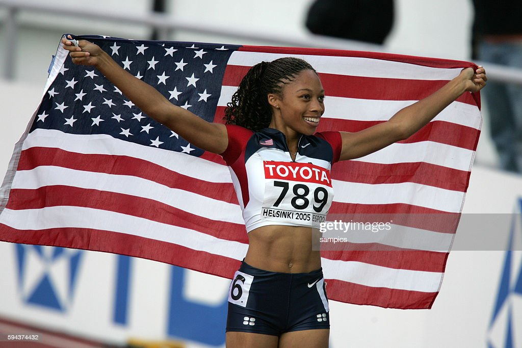 Allyson Felix celebrates her win in the women's 200 meter sprint at the IAAF World Championships in Helsinki Finland August 12 2005