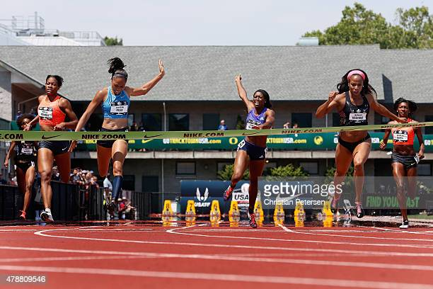 Allyson Felix crosses the finish line ahead of Natasha Hastings to win the Women's 400 Meter Dash final during day three of the 2015 USA Outdoor...