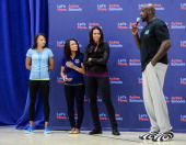 Allyson Felix Dominique Dawes US First Lady Michelle Obama and Shaquille O'Neal visit Orr Elementary in Washington DC for a back to school event...