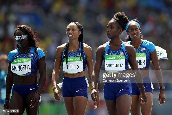 Allyson Felix English Gardner Morolake Akinosun and Tianna Bartoletta of the United States react during round one of the Women's 4 x 100m Relay on...
