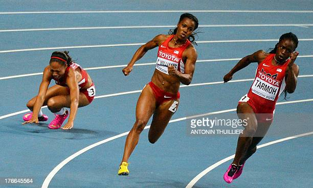 US Allyson Felix falls next to US ChaRonda Williams and US Jeneba Tarmoh during the women's 200 metres final at the 2013 IAAF World Championships at...