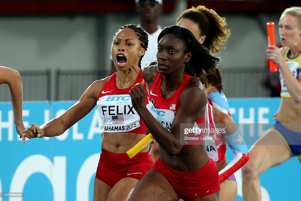 Allyson Felix hands the baton to Kimberlyn Duncan of the United States during round one of the women's 4 x 100 metres on day two of the IAAF/BTC...