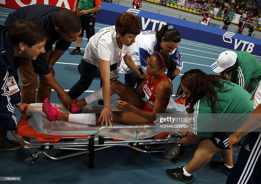 US Allyson Felix is placed on a stretcher after falling during the women's 200 metres final at the 2013 IAAF World Championships at the Luzhniki stadium in Moscow on August 16, 2013.