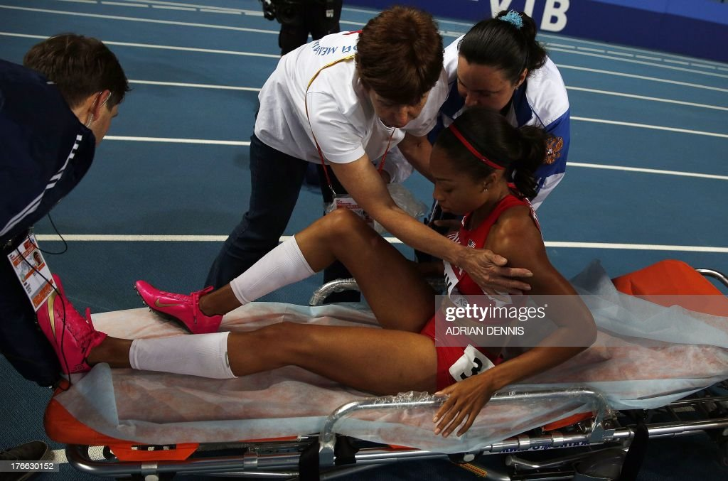 US Allyson Felix is put on a stretcher after falling during the women's 200 metres final at the 2013 IAAF World Championships at the Luzhniki stadium in Moscow on August 16, 2013. AFP PHOTO / ADRIAN DENNIS