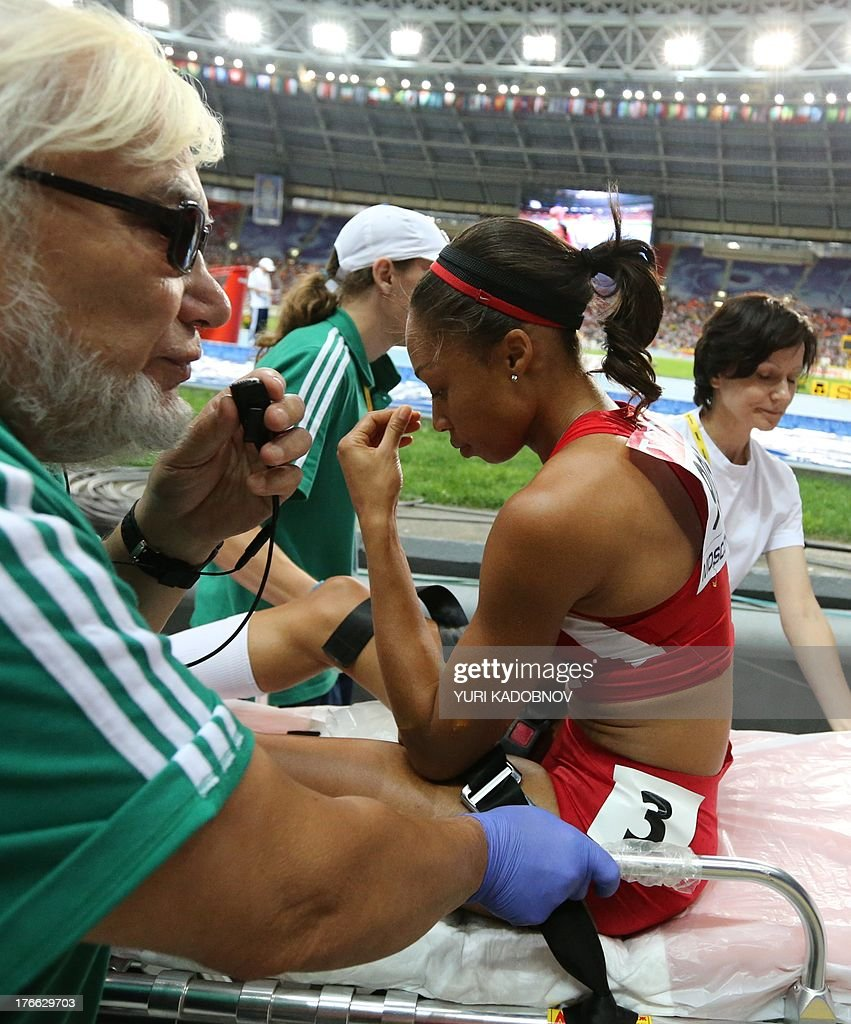 US Allyson Felix is taken away on a stretcher after the women's 200 metres final at the 2013 IAAF World Championships at the Luzhniki stadium in Moscow on August 16, 2013. KADOBNOV