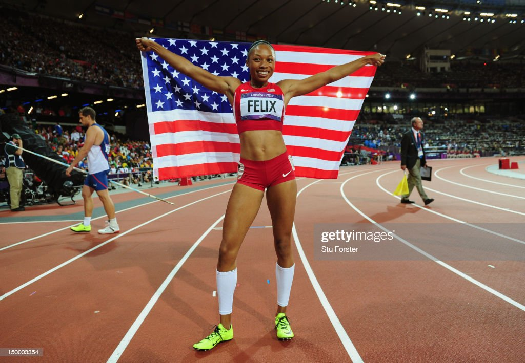 Allyson Felix of the United States celebrates after winning gold in the Women's 200m Final on Day 12 of the London 2012 Olympic Games at Olympic...