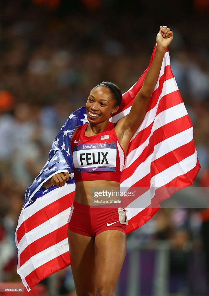 Allyson Felix of the United States celebrates after winning gold in the Women's 200m Final on Day 12 of the London 2012 Olympic Games at Olympic Stadium on August 8, 2012 in London, England.