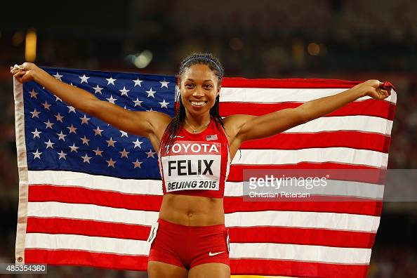 Allyson Felix of the United States celebrates after winning gold in the Women's 400 metres Final during day six of the 15th IAAF World Athletics...