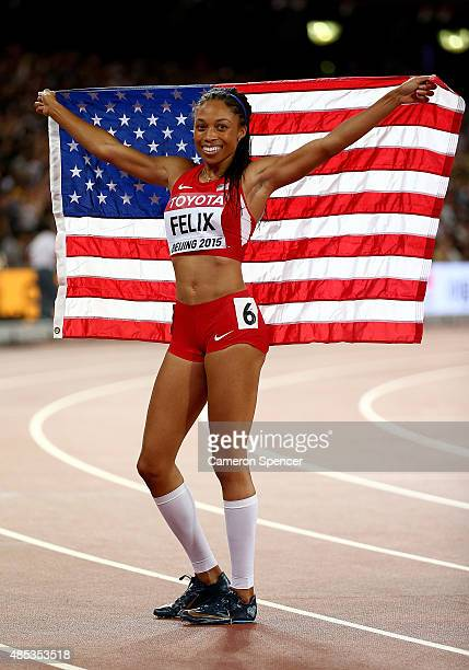 Allyson Felix of the United States celebrates winning gold in the Women's 400 metres Final during day six of the 15th IAAF World Athletics...