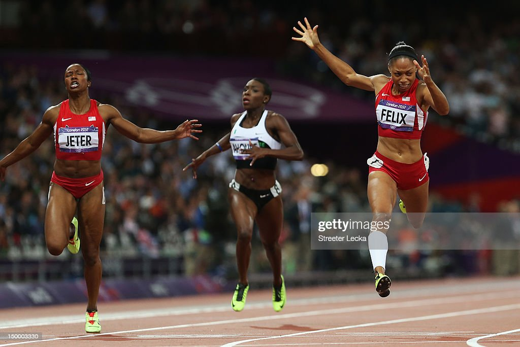 <a gi-track='captionPersonalityLinkClicked' href=/galleries/search?phrase=Allyson+Felix&family=editorial&specificpeople=213459 ng-click='$event.stopPropagation()'>Allyson Felix</a> of the United States crosses the finish line ahead of Murielle Ahoure of Cote d'Ivoire a and <a gi-track='captionPersonalityLinkClicked' href=/galleries/search?phrase=Carmelita+Jeter&family=editorial&specificpeople=4472760 ng-click='$event.stopPropagation()'>Carmelita Jeter</a> of the United States to win the Women's 200m Final on Day 12 of the London 2012 Olympic Games at Olympic Stadium on August 8, 2012 in London, England.