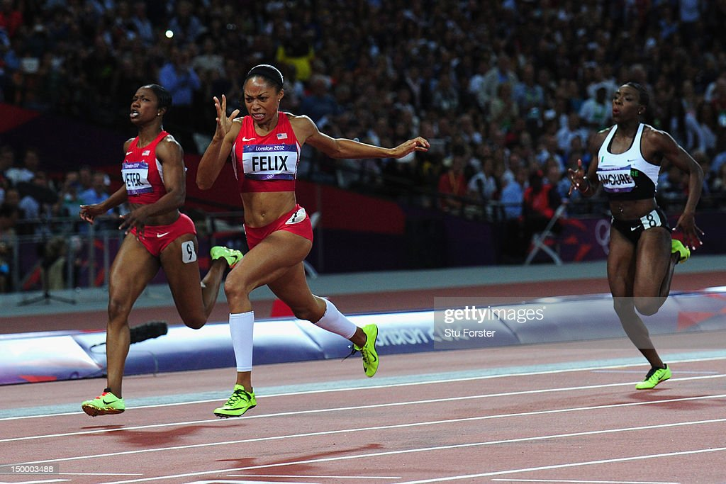 <a gi-track='captionPersonalityLinkClicked' href=/galleries/search?phrase=Allyson+Felix&family=editorial&specificpeople=213459 ng-click='$event.stopPropagation()'>Allyson Felix</a> of the United States crosses the finish line ahead of <a gi-track='captionPersonalityLinkClicked' href=/galleries/search?phrase=Murielle+Ahoure&family=editorial&specificpeople=7854673 ng-click='$event.stopPropagation()'>Murielle Ahoure</a> of Cote d'Ivoire a and <a gi-track='captionPersonalityLinkClicked' href=/galleries/search?phrase=Carmelita+Jeter&family=editorial&specificpeople=4472760 ng-click='$event.stopPropagation()'>Carmelita Jeter</a> of the United States to win the Women's 200m Final on Day 12 of the London 2012 Olympic Games at Olympic Stadium on August 8, 2012 in London, England.
