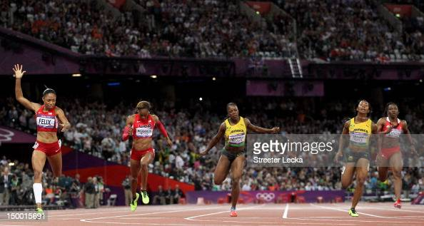 Allyson Felix of the United States crosses the finish line ahead of ShellyAnn FraserPryce of Jamaica and Sanya RichardsRoss of the United States to...