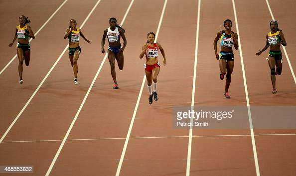 Allyson Felix of the United States crosses the finish line to win gold in the Women's 400 metres Final during day six of the 15th IAAF World...