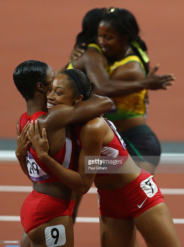 Allyson Felix of the United States hugs teammate Carmelita Jeter of the United States as ShellyAnn FraserPryce of Jamaica hugs her teammate Veronica...