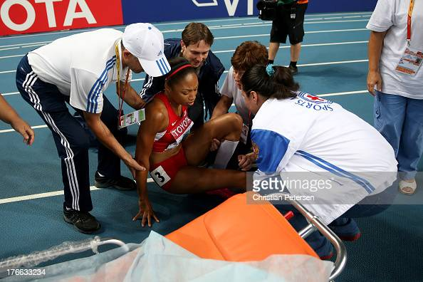 Allyson Felix of the United States is given assitance after pulling up in the Women's 200 metres final during Day Seven of the 14th IAAF World...