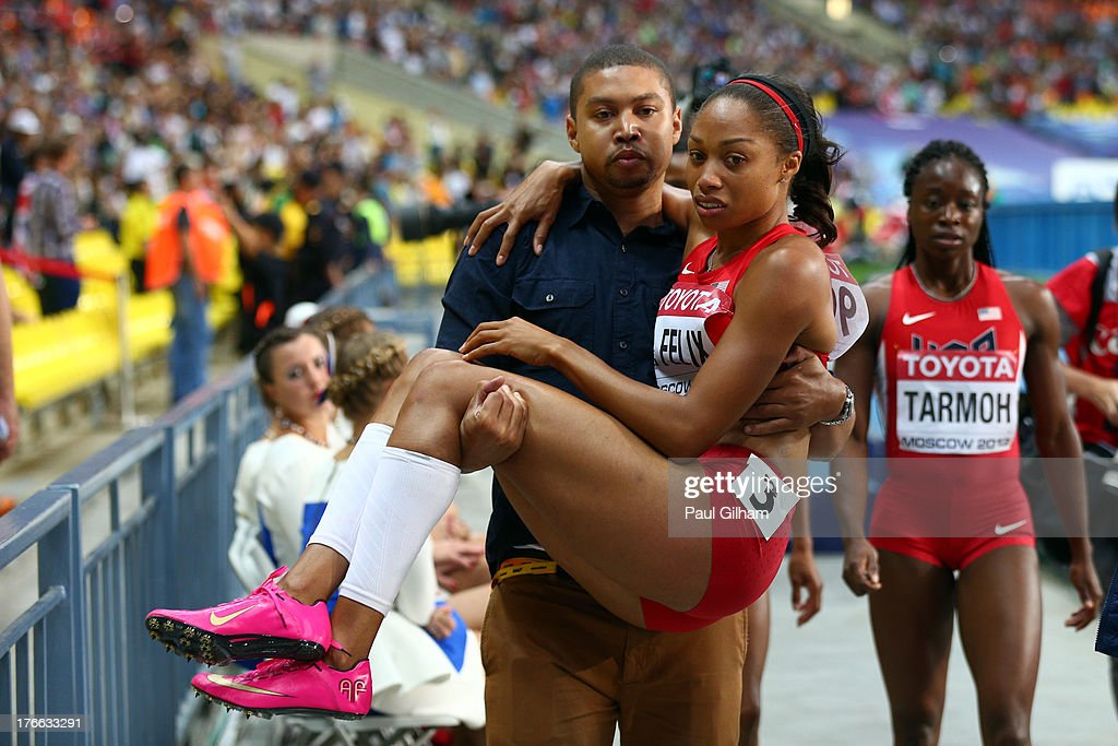 Allyson Felix of the United States is given assitance after pulling up in the Women's 200 metres final during Day Seven of the 14th IAAF World Athletics Championships Moscow 2013 at Luzhniki Stadium at Luzhniki Stadium on August 16, 2013 in Moscow, Russia.
