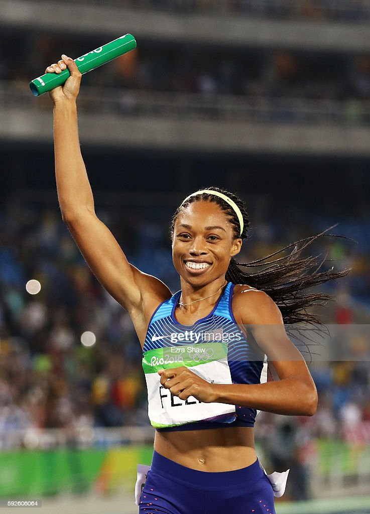 Allyson Felix of the United States reacts after winning gold during the Women's 4 x 400 meter Relay on Day 15 of the Rio 2016 Olympic Games at the...