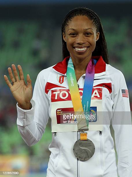 Allyson Felix of the USA poses with her silver medal after the women's 400 metres final during day three of the 13th IAAF World Athletics...