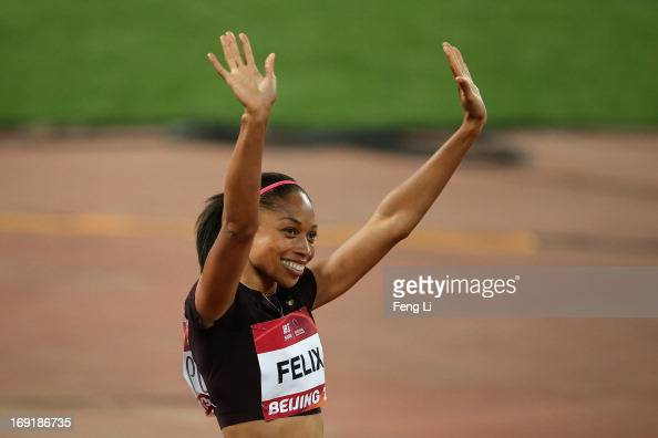 Allyson Felix of United States celebrates after she won the Women's 200 Metres at National Stadium also known as Bird's Nest during 2013 IAAF World...
