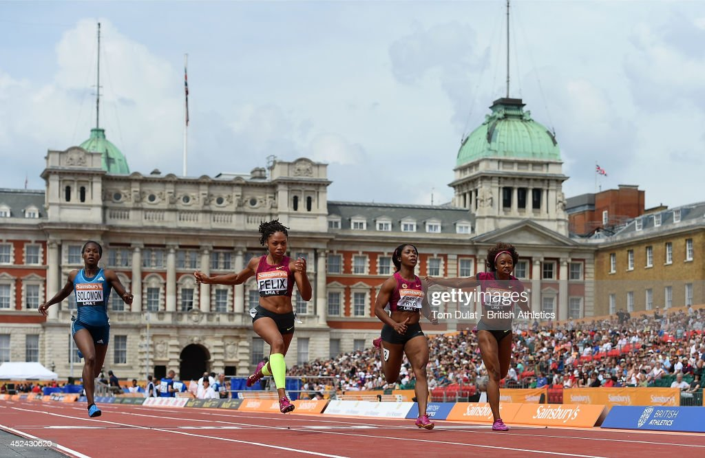 Allyson Felix of United States (2nd L) wins Women's 100 Meters Race during the Sainsbury's Anniversary Games at Horse Guards Parade on July 20, 2014 in London, England.