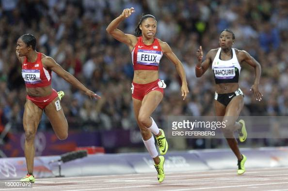 US' Allyson Felix reacts as she wins the women's 200m final ahead odf US' Carmelita Jeter at the athletics event of the London 2012 Olympic Games on...