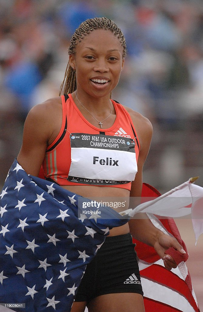Allyson Felix takes a victory with a United States flag after winning the women's 200 meters in 2234 in the USA Track Field Championships at Carroll...
