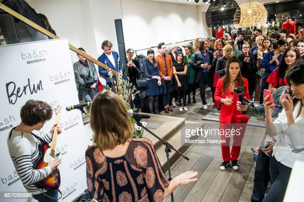 Alma Jodorowsky and David Baudart of the band Burning Paecocksperform during the BaSh store opening on March 23 2017 in Berlin Germany