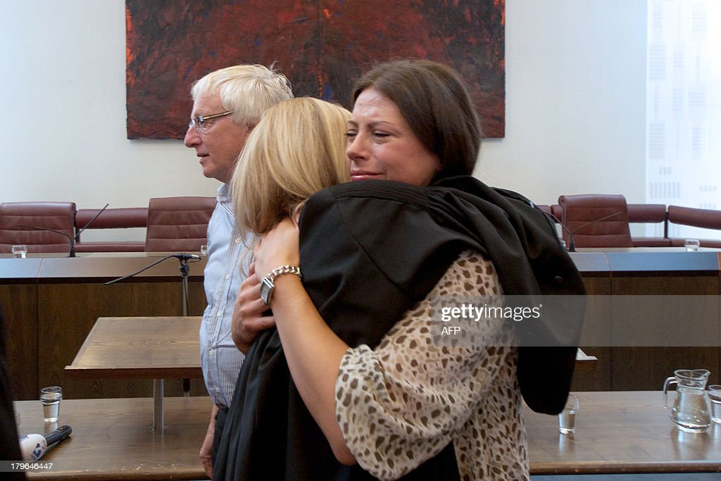 Alma Mustafic (R), the daughter of one of the victims, and her lawyer Liesbeth Zegveld embrace as they react to the ruling of the Supreme Court that the Netherlands is responsible for the deaths of three Muslim men after the fall of the Srebrenica enclave in 1995, on September 6, 2013 in The Hague. The Dutch state is responsible for sending three Bosnian Muslims to their deaths when they were expelled from a UN compound at Srebrenica in 1995, the supreme court ruled today. The final ruling in the long-running case means that former UN interpreter Hasan Nuhanovic, whose father, mother and brother were killed by Bosnian Serb forces after Dutch peacekeepers expelled them from the UN base, can seek compensation from the Dutch state.