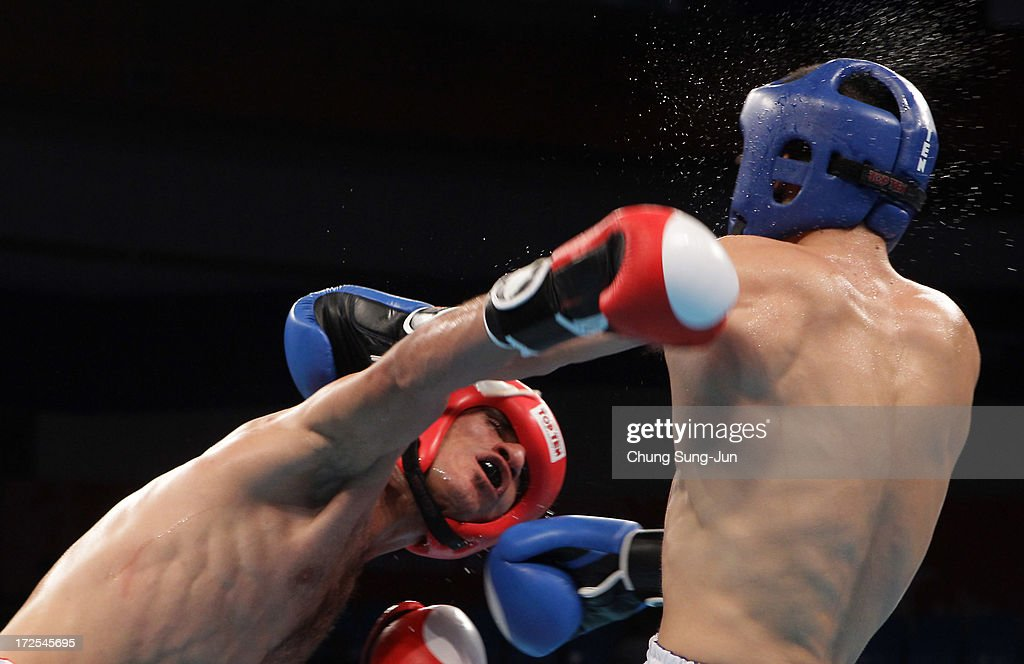Almalkee Ahmad Hassan Majed (Red) of Iraq competes with Phan Van Yen (Blue) of Vietnam in the Kickboxing, Full Contact Men's 63.5kg Round of 16 at Dowon Gymnasium during day five of the 4th Asian Indoor Martial Arts Games on July 3, 2013 in Incheon, South Korea.