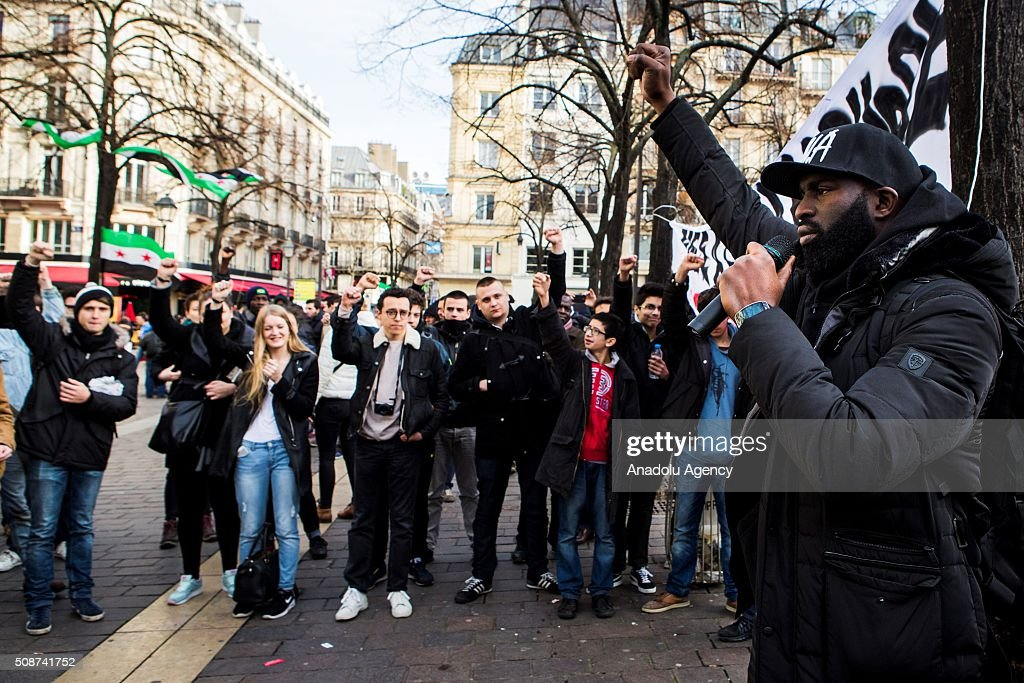 Almamy Kanoute addresses the crowd gathered at Fontaine des Innocents during a protest against extreme right, 'Islamophobia' and all forms of racism in Paris, France on February 6, 2016.