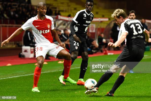 Almamy Toure of Monaco and Ismaila Sarr and Franck Signorino of Metyz during the Ligue 1 match between As Monaco and Fc Metz at Louis II Stadium on...