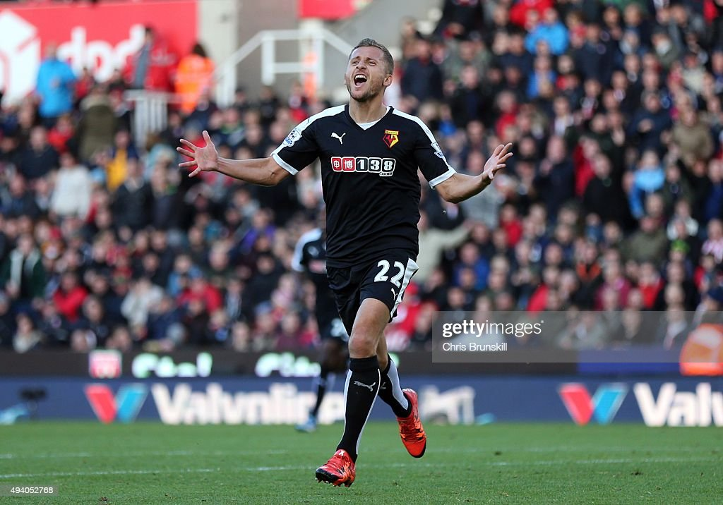 Alman Abdi of Watford celebrates scoring his side's second goal during the Barclays Premier League match between Stoke City and Watford on October 24, 2015 in Stoke on Trent, England.